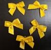 Бантики атлас КЦ289-7 (желтый) Цена за 50 шт